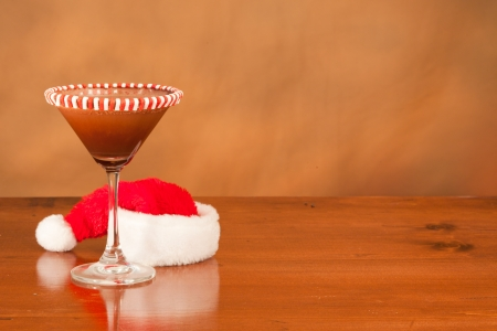Christmas drink on a bar top with a santa hat  behind it Stock Photo - 16710433