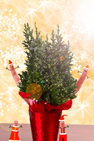 the magic of christmas represented by finger people and a small tree with stars and sparkles Stock Photo - 16747362