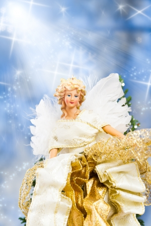 close up of a christmas angel with back lit feathers for wings Stock Photo - 16847513