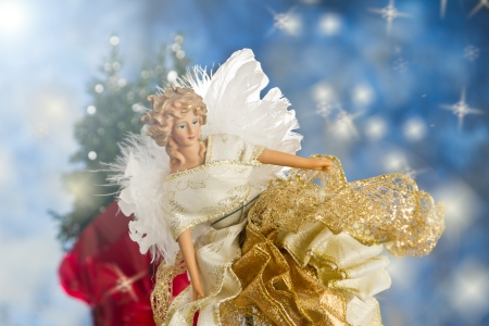 close up of a christmas angel with back lit feathers for wings Stock Photo - 16847511