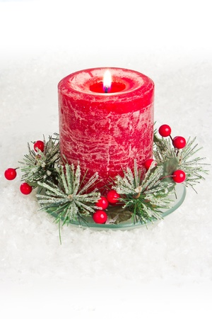 holiday candle or centerpiece on white fake snow as a background Stock Photo - 16847490
