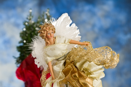close up of a christmas angel with back lit feathers for wings Stock Photo - 16847512