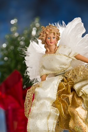 close up of a christmas angel with back lit feathers for wings Stock Photo - 16847515