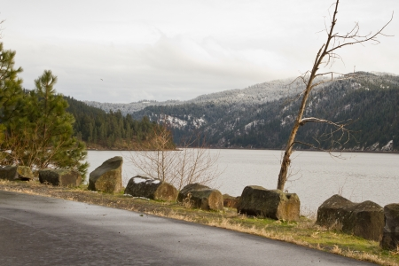 winter scene in coeur d Alene lake with frozen mountaintops in the distance Stock Photo - 16981824