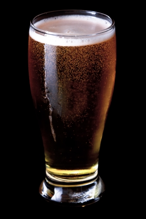 resfreshing beer served over a black background Stock Photo - 17170824