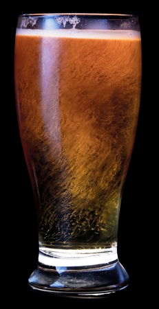 resfreshing beer served over a black background Stock Photo - 17170969