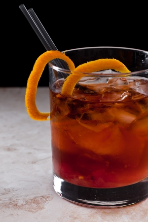 twist: old fashioned cocktail garshied with an orange twist Stock Photo