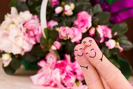 trio: concepto de un tr�o de San Valent�n con un fondo de flores Foto de archivo