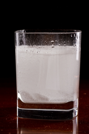 seltzer: tablets disolving in a glass with water as an alkaline treatment