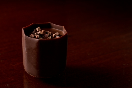 decadent: small decadent chocolate serving in a dark set up