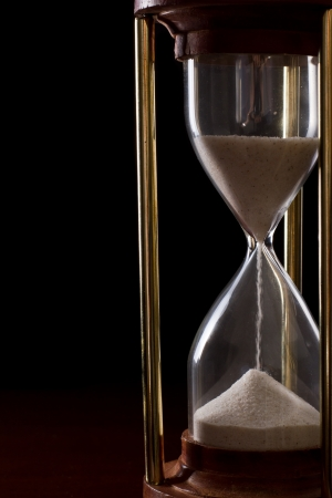 hourglass on a dark setting, concept of time passing Stock Photo - 17445902