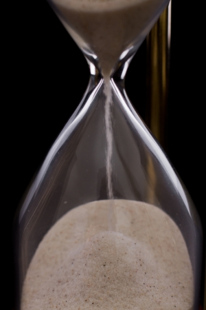 hourglass on a dark setting, concept of time passing Stock Photo - 17445914