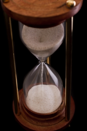 hourglass on a dark setting, concept of time passing Stock Photo - 17445892