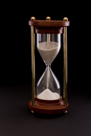 hourglass on a dark setting, concept of time passing Stock Photo - 17445889