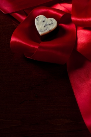 dark chocolate with cream and cocoa nibs on a red silk Stock Photo - 17445905