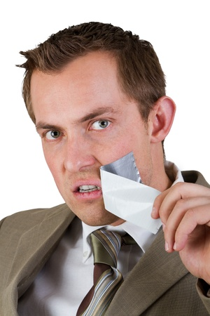 duct: confident business man taking of duct tape from his mouth to speak loudly