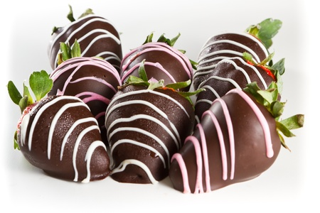 dipped: chocolate covered strawberries on a white table top