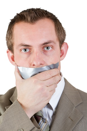 business man with duct  tape over his mouth on a white background photo