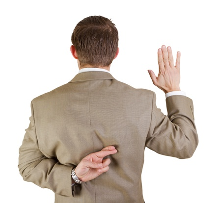 back side of a business man with his right hand up and left hand behind his back with fingers crossed Stock Photo - 17567008