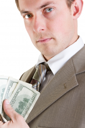 young profitable business man with hundred dollar bills in his hand photo