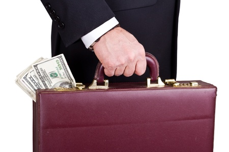 money packs: closeup of a businessman holding a briefcase with cash isolated on a white background