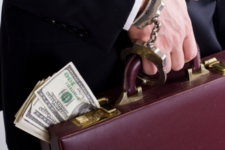 suitcase with american dollars handcuffed to a businessman hand Stock Photo - 17840683
