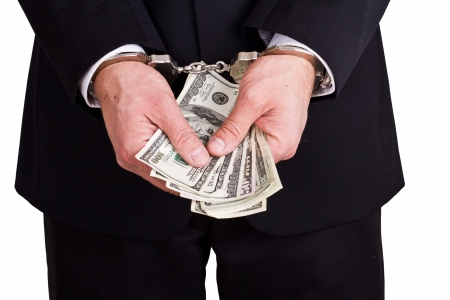 arrested businessman holding hundred dollar bills isolated on a white background Stock Photo - 17840677