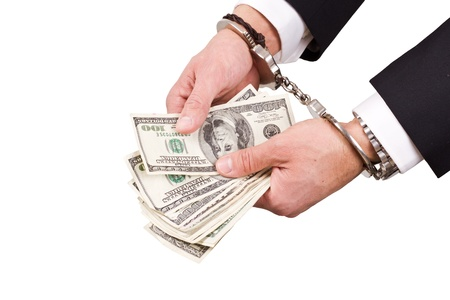 arrested businessman holding hundred dollar bills isolated on a white background Stock Photo - 17840646