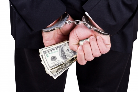 arrested businessman holding hundred dollar bills isolated on a white background Stock Photo - 17840696