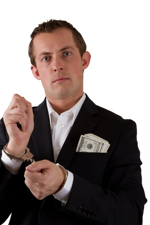 young business man with handcuffs on isolated on a white background Stock Photo - 17799694