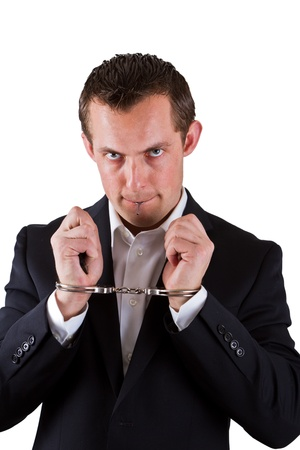 young business man with handcuffs on isolated on a white background photo