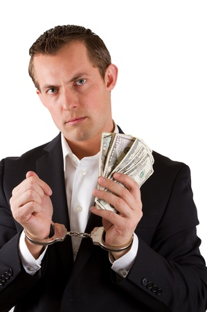 arrested businessman holding hundred dollar bills isolated on a white background Stock Photo - 17799699