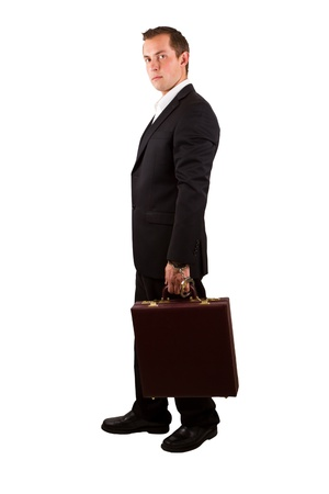 closeup of a businessman holding a briefcase with handcuffs isolated on a white background photo