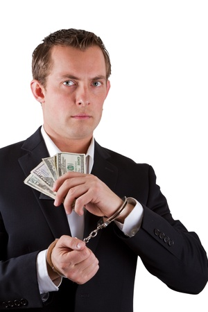 arrested businessman holding hundred dollar bills isolated on a white background