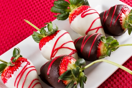 chocolate covered strawberries with dark and white chocolate photo