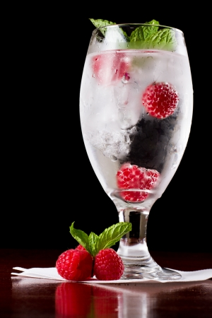refreshing ice cold water with fresh raspberries and mint photo
