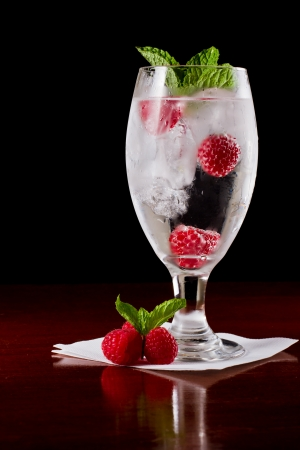 challis: refreshing ice cold water with fresh raspberries and mint Stock Photo