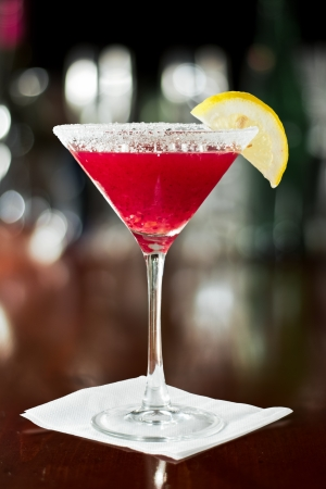 closeup of a lemon drop martini on a busy bar with glassware in the background Stock Photo - 18170228