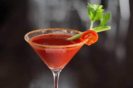 closeup of a bloody mary cocktail isolated on a busy bar top