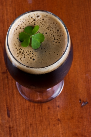 colorful green shamrock floating on top of an irish beer Stock Photo - 18680090