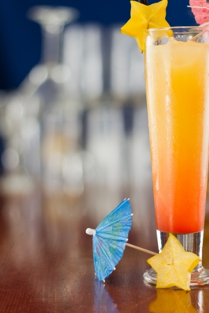 alcohol screwdriver: fresh tropical juices mixed and served in a glass decorated with a carambola slice and a parasol