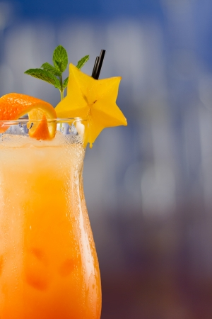 alcohol screwdriver: fresh tropical juices mixed and served in a glass decorated with a carambola slice and fresh mint