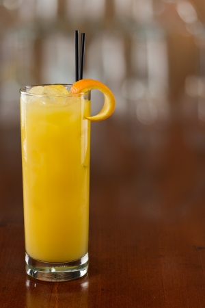 alcohol screwdriver: fresh glass of orange juice served on a busy bar top Stock Photo