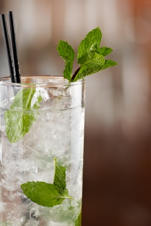 muddle: traditional mojito cocktail with fresh mint  served on a busy bar top Stock Photo