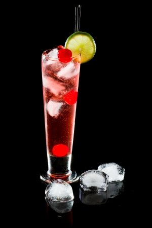 quinine: refreshing red cocktail with sparkling water and ice garnished with a lime and cherry
