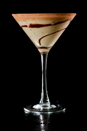 chocolate martini isolated on a black background with chocolate swirl and cocoa powder on the rim Stock Photo