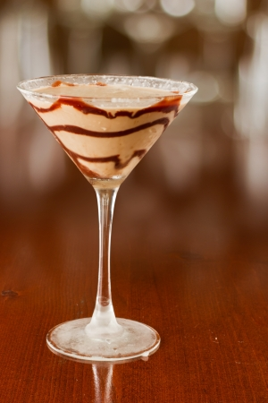 chocolate martini served on busy out of focus bar top