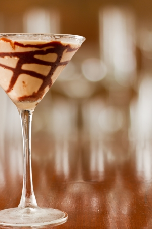 chocolate martini served on busy out of focus bar top photo