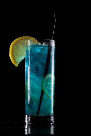 tall glass: bright blue lemonade served in a tall glass isolated on a black background