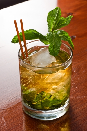 kentucky derby: close up of a mint julep served on the rocks and garnished with fresh green mint on top, kentucky derby drink